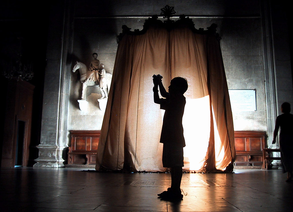 Boy photographing, Lucca Cathedral, Italy